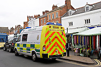 Ambulance in Banbury Market Oxfordshire waiting for Paramedic crew with a female patient on stretcher. This image may only be used to portray the subject in a positive manner..©shoutpictures.com..john@shoutpictures.com.