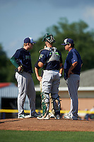 Vermont Lake Monsters pitcher Kevin Duchene (10) talks with pitching coach Carlos Chavez (right) as catcher Nick Collins (20) looks on during the first game of a doubleheader against the Batavia Muckdogs August 11, 2015 at Dwyer Stadium in Batavia, New York.  Batavia defeated Vermont 6-0.  (Mike Janes/Four Seam Images)