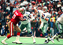 Dallas Cowboys Troy Aikman (8) during a game from his career with the Dallas Cowboys, Troy Aikman played for 12 years, with all with the Cowboys, was a 6-time Pro Bowler and was inducted to the Pro Football Hall of Fame in 2006.(SPORTPICS)