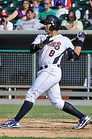 Tennessee Smokies third baseman Greg Rohan #8 homers during game one of a double header against the  Pensacola Blue Wahoos at Smokies Park on July 30, 2012 in Kodak, Tennessee. The Smokies won both ends of the double header 6-3 in game one and 3-2 in game two. (Tony Farlow/Four Seam Images).