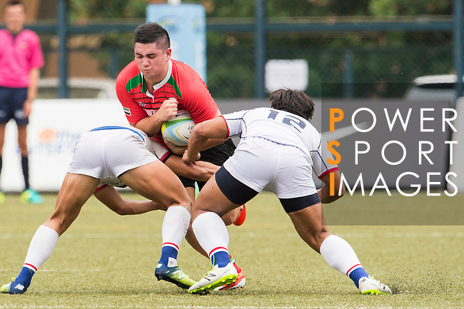 Tuharangi Kahukuranui (c) of United Arab Emirates battles for the ball against South Korea's players during the match between South Korea and United Arab Emirates of the Asia Rugby U20 Sevens Series 2016 on 12 August 2016 at the King's Park, in Hong Kong, China. Photo by Marcio Machado / Power Sport Images