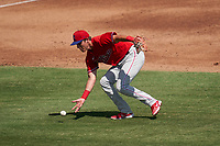 Philadelphia Phillies third baseman Nick Maton (67) fields a ground ball with his bare hand during a Major League Spring Training game against the Baltimore Orioles on March 12, 2021 at the Ed Smith Stadium in Sarasota, Florida.  (Mike Janes/Four Seam Images)
