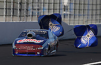 Feb. 16, 2013; Pomona, CA, USA; NHRA pro stock driver Jason Line races with tape on the front end of his car after rear ending a golf cart in the staging lanes during qualifying for the Winternationals at Auto Club Raceway at Pomona.. Mandatory Credit: Mark J. Rebilas-