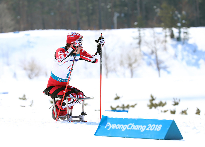 Ethan Hess, Pyeongchang 2018. Para Nordic Skiing // Ski paranordique.<br /> Ethan Hess competes in the 15k sitting cross country // Ethan Hess participe au cross-country assis sur 15 km. 11/03/2018.