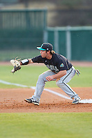 Coastal Carolina Chanticleers first baseman Richard Carter (10) stretches for a throw during the game against the High Point Panthers at Willard Stadium on March 15, 2014 in High Point, North Carolina.  The Panthers defeated the Chanticleers 11-8 in game two of a double-header.  (Brian Westerholt/Four Seam Images)