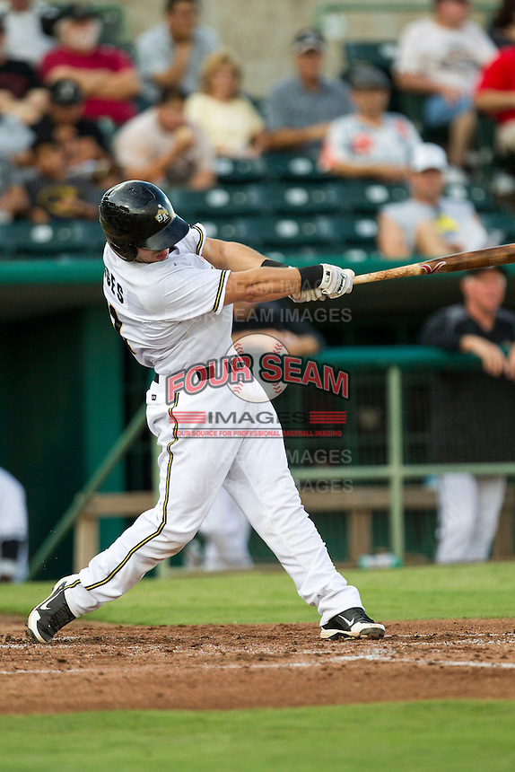San Antonio Missions catcher Austin Hedges (21) swings the bat in the Texas League baseball game against the Frisco Roughriders on August 22, 2013 at the Nelson Wolff Stadium in San Antonio, Texas. Frisco defeated San Antonio 2-1. (Andrew Woolley/Four Seam Images)