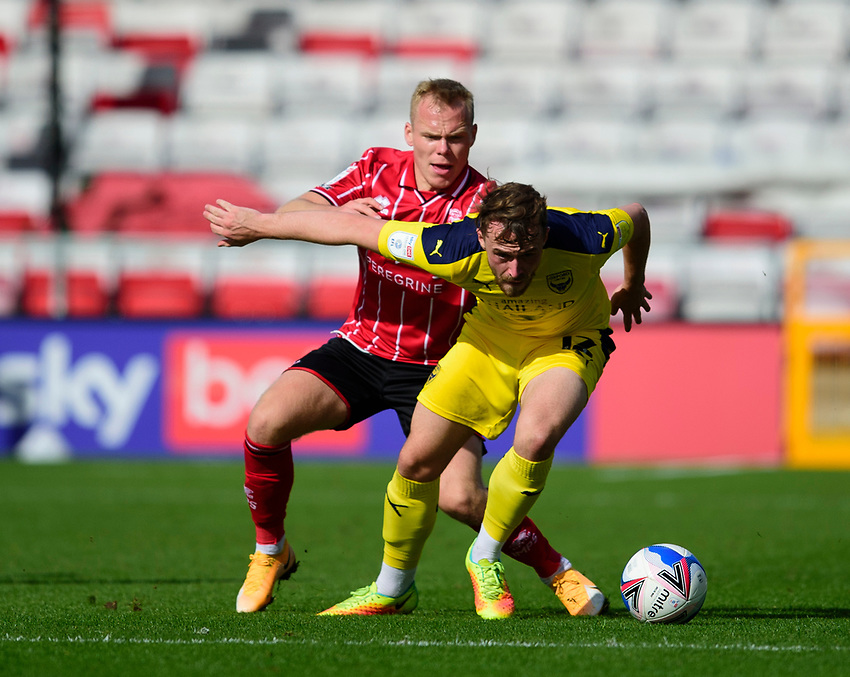 Lincoln City's Anthony Scully battles with Oxford United's Sam Long<br /> <br /> Photographer Andrew Vaughan/CameraSport<br /> <br /> The EFL Sky Bet League One - Saturday 12th September  2020 - Lincoln City v Oxford United - LNER Stadium - Lincoln<br /> <br /> World Copyright © 2020 CameraSport. All rights reserved. 43 Linden Ave. Countesthorpe. Leicester. England. LE8 5PG - Tel: +44 (0) 116 277 4147 - admin@camerasport.com - www.camerasport.com - Lincoln City v Oxford United