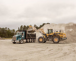 October 8, 2019. Cary, North Carolina.<br /> <br /> A dump truck is loaded with aggregate at the Wake Stone Corp. Triangle Quarry. Wake Stone has a contract in place with the RDU Airport Authority to expand the quarry onto their land, bu tit is being challenged in court by multiple parties trying to halt the expansion.<br /> <br /> The proposed expansion of a Wake Stone Corp. granite aggregate quarry onto land owned by the Raleigh-Durham International Airport, which also borders Umstead State Park, has ignited a debate about what to do with unused public land and brought to the surface the conflict between recreation and the residential growth of the area. <br /> <br /> Jeremy M. Lange for The Wall Street Journal