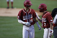 Arkansas infielder Matt Goodheart (10) and Cayden Wallace (7) embrace following a score, Saturday, June 5, 2021 during the first inning in the second game of the NCAA Fayetteville Regional at Baum-Walker Stadium in Fayetteville. Check out nwaonline.com/210606Daily/ for today's photo gallery. <br /> (NWA Democrat-Gazette/Charlie Kaijo)