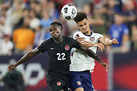 NASHVILLE, TN - SEPTEMBER 5: Richie Laryea #22 of Canada and Antonee Robinson #5 of USA battle during a game between Canada and USMNT at Nissan Stadium on September 5, 2021 in Nashville, Tennessee.