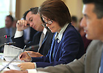 Nevada Attorney General Catherine Cortez Masto works during a Board of Examiners meeting at the Capitol in Carson City, Nev., on Monday, Aug. 15, 2011..Photo by Cathleen Allison