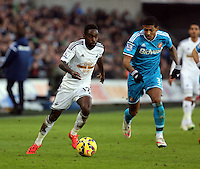 SWANSEA, WALES - FEBRUARY 07: L-R Nathan Dyer of Swansea marked by Patrick Van Aanholt of Sunderland during the Premier League match between Swansea City and Sunderland AFC at Liberty Stadium on February 7, 2015 in Swansea, Wales.