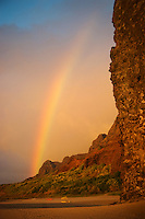 A rainbow over Kalalau Beach and cliffs, Na Pali Coast, Kaua'i.