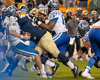 Pitt defensive lineman Amir Watts sacks Duke quarterback Daniel Jones. The Pitt Panthers football team defeated the Duke Blue Devils 54-45 on November 10, 2018 at Heinz Field, Pittsburgh, Pennsylvania.