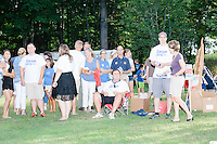 People look on as Republican presidential candidate Dr. Ben Carson meets with people at Londonderry Old Home Day in Londonderry, New Hampshire.