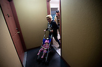 Shatha Sulaiman Kheder, (center), her husband Adil Kheder Nimr, (right) and their son Steven Adil Kheder, 10 months, head out for a walk from their new apartment in Tukwila, Washington on January 30, 2017.  The family arrived in the United States on as refugees from Iraq on January 19, 2017, the day after Donald Trump was sworn in as the 45th president of the United States. They are concerned about thirteen of their family members still in Iraq. Trump signed an executive order last Friday   restricting immigration from seven Muslim countries, suspending all refugee admission for 120 days, and bans all Syrian refugees indefinitely.  (Photo by Karen Ducey)