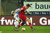 Dominique Heinz (Koeln) stoppt Marcel Heller (Darmstadt) im Strafraum - SV Darmstadt 98 vs. 1. FC Koeln, Stadion am Boellenfalltor