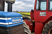 BNPS.co.uk (01202) 558833. <br /> Pic: Cheffins/BNPS<br /> <br /> Pictured: This 1983 County 1474 with less than 100 hours in the past 25 years and a 1974 Massey Ferguson 1200 <br /> <br /> A farming family is today celebrating after their incredible collection of almost 100 vintage tractors sold for a staggering £1million.<br /> <br /> Father and son duo Ian and Martin Liddell began hoarding the agricultural vehicles at their arable farm in the 1980s.<br /> <br /> Their fleet of tractors was so large that they had to be stored in three barns.<br /> <br /> The prized collection sparked a worldwide bidding war when it was sold with auctioneers Cheffins, of Cambridge, after the family decided to part with the tractors to free up space on their Essex farm to pursue other projects.