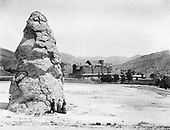 0405-D01 Liberty Cap, and National Hotel, Yellowstone National Park.  Later known as the Mammoth Hot Springs Hotel.  Construction began in 1889.  This photo was taken before 1911, when the fourth floor was removed and the roof flattened. It was demolished in 1936.