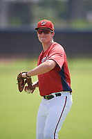 GCL Nationals Parker Quinn (17) during warmups before a Gulf Coast League game against the GCL Astros on August 9, 2019 at FITTEAM Ballpark of the Palm Beaches training complex in Palm Beach, Florida.  GCL Nationals defeated the GCL Astros 8-2.  (Mike Janes/Four Seam Images)