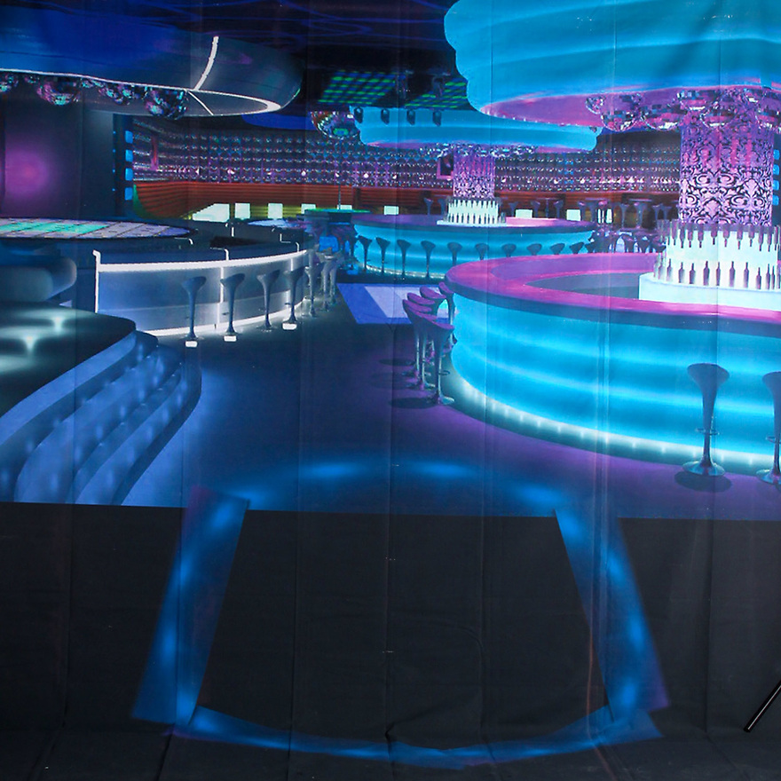 Backdrop featuring a swanky neon-lit cocktail lounge, nightclub bar where one might see a spy like James Bond 007, enjoying a drink and night life