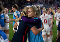 ORLANDO, FL - MARCH 05: Ashlyn Harris #18 of the United States hugs Rachel Daly #2 of England during a game between England and USWNT at Exploria Stadium on March 05, 2020 in Orlando, Florida.