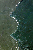 aerial photograph of a tide line in San Francisco Bay; Pacific Ocean water reaching the sediment filled water flowing out through San Francisco Bay during a flood tide