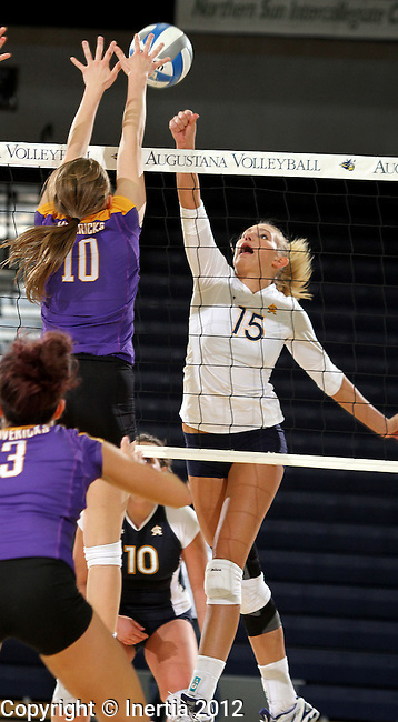 SIOUX FALLS, SD - OCTOBER 26:  Jordan Spatenka #15 from Augustana tips the ball as Ellie Van De Steeg #10 from Minnesota State University Mankato defends in the second game of their match Friday night at the Elmen Center. (Photo by Dave Eggen/Inertia)