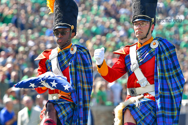 September 18, 2021; Two members of the Irish Guard carry the U.S. flag before the game against the Purdue Boilermakers. (photo by Matt Cashore/University of Notre Dame)