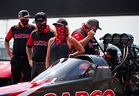 Aug 9, 2020; Clermont, Indiana, USA; Kay Torrence stands alongside the dragster of husband, NHRA top fuel driver Billy Torrence during the Indy Nationals at Lucas Oil Raceway. Mandatory Credit: Mark J. Rebilas-USA TODAY Sports