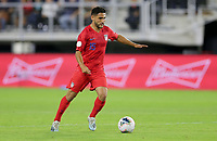 WASHINGTON, D.C. - OCTOBER 11: Cristian Roldan #15 of the United States dribbles the ball during their Nations League game versus Cuba at Audi Field, on October 11, 2019 in Washington D.C.