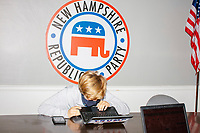 Campaign workers and volunteers participate in a phone bank get out the vote effort hosted by New Hampshire Trump Victory in the office of the New Hampshire Republican State Committee in Concord, New Hampshire, on Wed., Sept. 16, 2020.