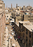Cairo, Egypt -- View from the minarets of the Bab Zuwayla gate.  One of the three first gates installed around the historic walled city of Cairo, standing at the southern boundary of old Fatimid Cairo.  The two minarets atop this tower actually belong to the nearby Mosque of al-Mu'ayyad, which sits just inside this gate (on the left).  For a small fee, it is possible to climb the minarets for a spectacular view of old and new Cairo. © Rick Collier / RickCollier.com