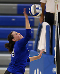Marymount's Erin Allison gets a kill during a college volleyball match at Washington & Lee University Lexington, Vir., on Saturday, Oct. 5, 2013.<br /> Photo by Cathleen Allison