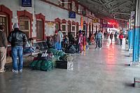 India, Dehradun.  Passengers Waiting on Platform at Train Station.