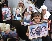 """Family prisoners stage sit  in The International Red Cross, demanding the release of their sons, after the Israeli decision to release 250 prisoners from the Fatah movement, July 9, 2007 .""""photo Fady Adwan"""""""