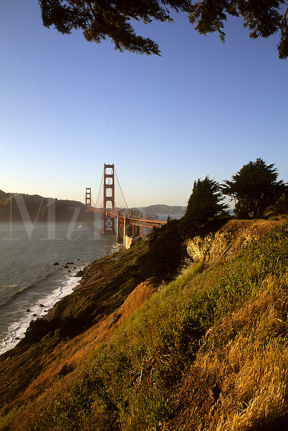 Famous Landmark of San Francisco the Golden Gate Bridge from unusual angle looking north across bay into Marin Count