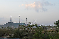 India, Gujarat, Kutch desert, Bhadroi Village. Sunrise with cell towers.