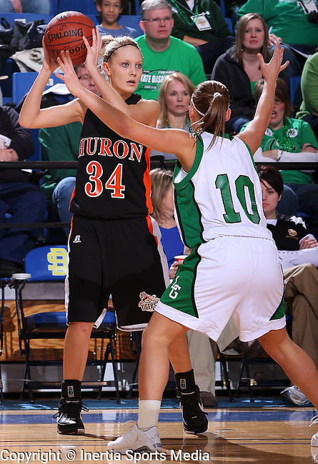 BROOKINGS, SD - March 12, 2009 : Taylor Carlson #34 of Huron looks to pass to a teammate while under pressure from Amanda Stout #10 of Pierre in the first half of their State Girls AA Tournament game at Frost Arena in Brookings on Thursday. (Photo By Stephen Brua/ Inertia)