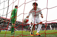 Alberto Palosch of Swansea City collects the ball out of the net after Gylfi Sigurdsson scores his sides second goal during the Barclays Premier League match between AFC Bournemouth and Swansea City played at The Vitality Stadium, Bournemouth on March 12th 2016