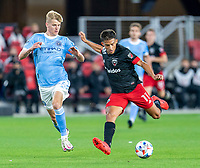 WASHINGTON, DC - APRIL 17: Yamil Asad #11 of D.C. United strikes the ball during a game between New York City FC and D.C. United at Audi Field on April 17, 2021 in Washington, DC.