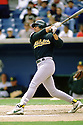 CHICAGO - CIRCA 1997:  José Canseco #33 of the Oakland Athletics bats during an MLB game at Comiskey Park in Chicago, Illinois. Canseco played for 17 season for 7 different teams, was a 6-time All-Star and was the 1988 American League MVP.(David Durochik / SportPics) --José Canseco