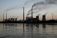 A power station on the western bank of the Yellow River lets out smoke in northern Ningxia Hui Autonomous Region, China. According to the first-quarter report of the State Environmental Protection Administration (SEPA), pollution across the country has been worsening and foul air emissions are beyond acceptable limits. Pollution index in some cities is above 300. Worsening air and water pollution made cancer the top killer in China last year..18 May 2007