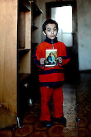 The residence of Lunik IX, child picks up the photograph of his sister so that she is included.