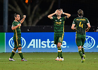 LAKE BUENA VISTA, FL - JULY 18: Diego Valeri #8 of the Portland Timbers celebrates his goal as teammates Sebastián Blanco #10 and Jorge Villafaña #4 join during a game between Houston Dynamo and Portland Timbers at ESPN Wide World of Sports on July 18, 2020 in Lake Buena Vista, Florida.