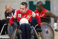 27 MAY 2013 - DONCASTER, GBR - Paul McDerby of the East Midlands Marauders races for the goal line during the teams 5th / 6th position decider against the Leicester Tigers at the 2013 Great Britain Wheelchair Rugby Nationals at The Dome in Doncaster, South Yorkshire (PHOTO (C) 2013 NIGEL FARROW)