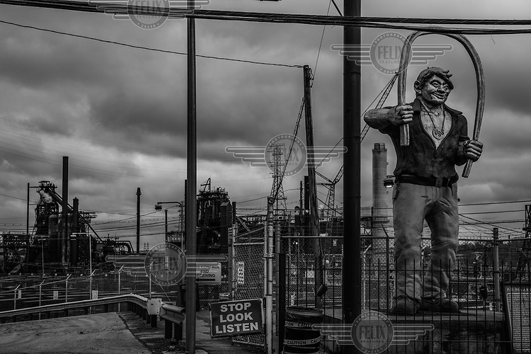 A statue of a worker at the entrance to the Edgar Thomson steel mill in the town of Braddock. <br /><br />In the late 19th century, the coal producing Pittsburgh region became the cradle of the American steel industry and when industrialist Andrew Carnegie built the Edgar Thomson mill it was one of the first in America to use the Bessemer process.<br /><br />The population of Pittsburgh, the urban area that Braddock is a part of, has halved since its 1960s high point. Like many of the so-called rust belt states, Pennsylvania's heavy industries have declined due to globalisation, automation and a move away from polluting industries. The resulting de-industrialisation has led to rising unemployment or wage stagnation, falling urban populations and rising inequality.