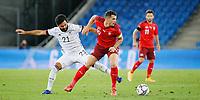 6th August 2020, Basel, Switzerland. UEFA National League football, Switzerland versus Germany;  İlkay Gündoğan, Germany held off by Granit Xhaka Switzerland