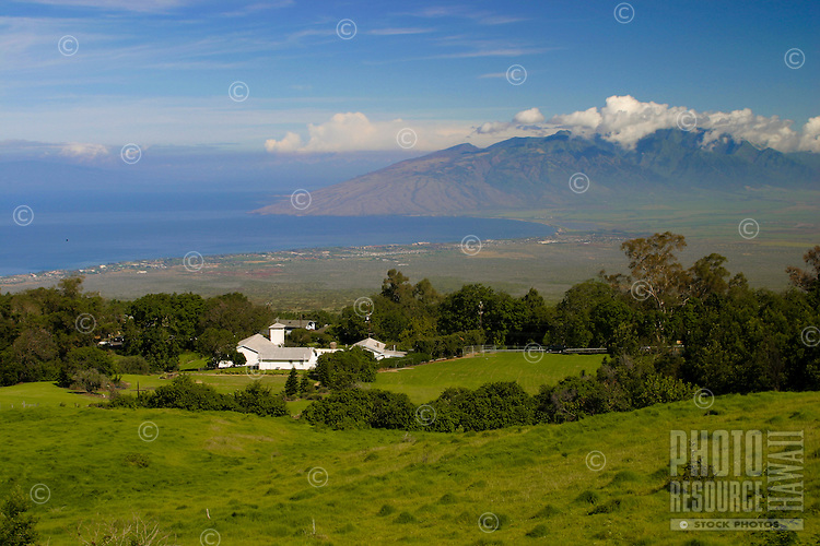 A view of the green pastures of upcountry Maui.  West Maui mountains in the background.