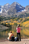 Caucasian woman being ignored by her boy friend, at Maroon Lake and the Maroon Bells, west of Aspen, Colorado.